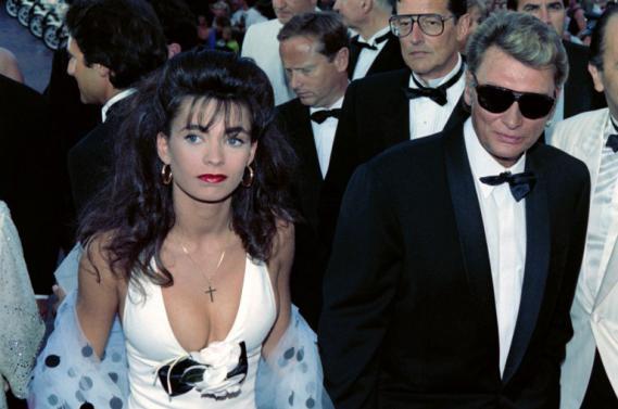 Adeline Blondieau et Johnny Hallyday le 10 mai 1990, au Festival de Cannes.