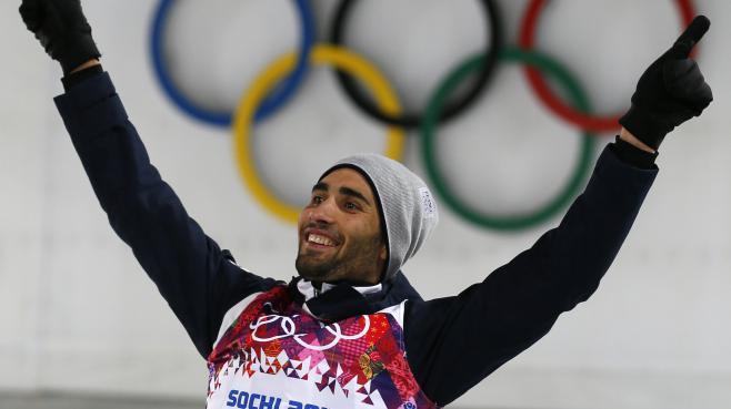 Le Français Martin Fourcade célèbre sa seconde médaille d'or aux JO de Sotchi (Russie), le 13 février 2014.