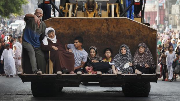 Des Palestiniens fuient Gaza, le 20 juillet 2014.