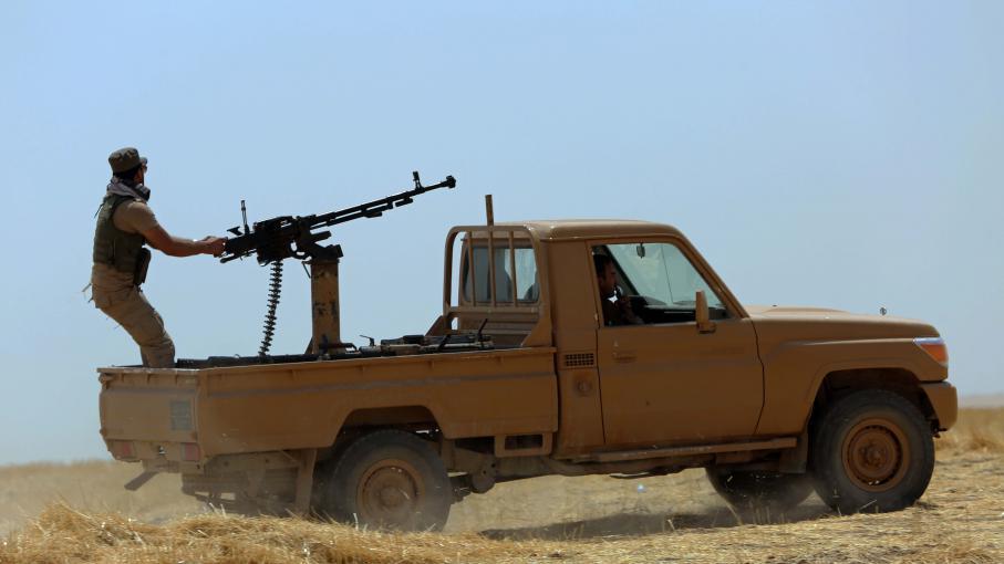 Un peshmerga kurde, le 5 août 2014 dans les environs de Mossoul (Irak) lors de combats contre l'Etat islamique.