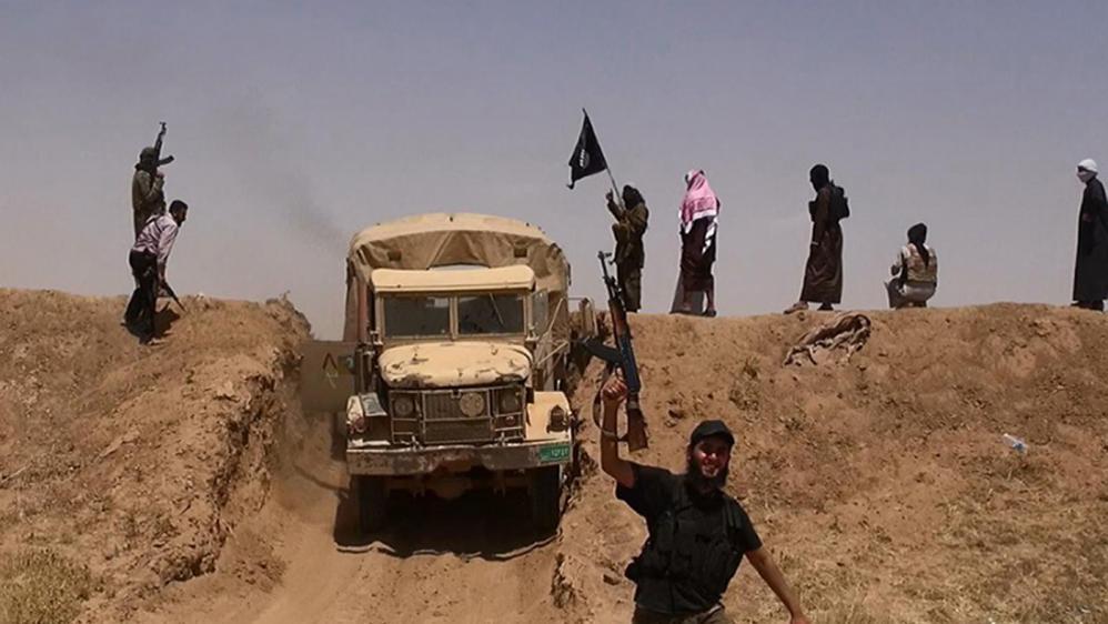 Une photo de jihadistes de l'Etat islamique en Syrie, diffusée sur le compte Twitter deAl-Baraka news, le 11 juin 2014.