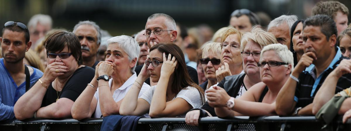 People attend July 28, 2016 in honor of  Jacques Hamel priest murdered two days earlier in  the attack perpetrated in Saint-Etienne-du-Rouvray  (Seine-Maritime).