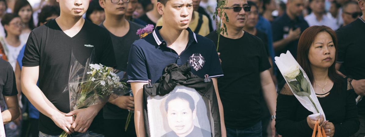 Des membres de la communauté chinoise d'Aubervilliers (Seine-Saint-Denis) manifestent le 14 août 2016 après la mort d'un de leurs membres, agressés quelques jours plus tôt.