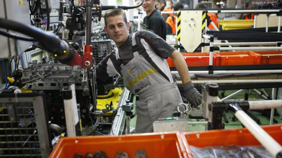 Worker on a chain of the Renault plant of  Cléon.
