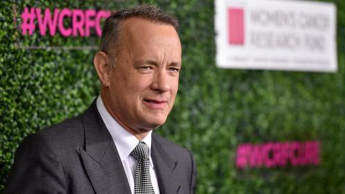 """""""J'ai un tas d'albums chez moi"""" : Tom Hanks explique être un fan de la première heure de Johnny Hallyday"""