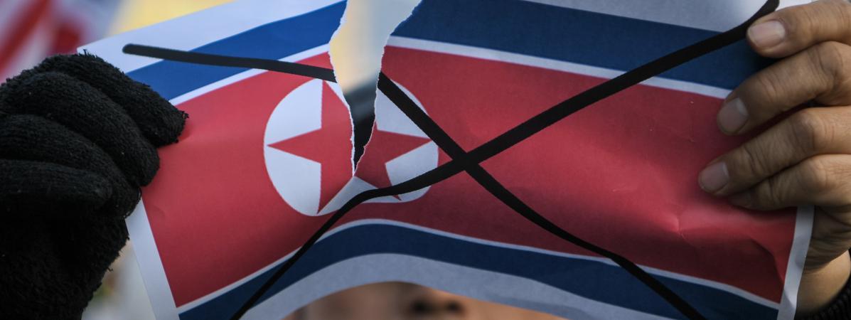 Un manifestant dénonce la présence de la Corée du Nord aux Jeux olympiques 919b58bedfb