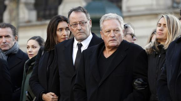Jean Reno and André Boudou, at the funeral of Johnny Hallyday, December 9, 2018, in front of the church of La Madeleine, in Paris.