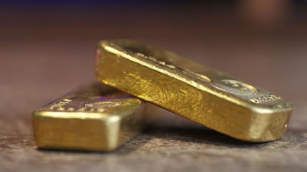 Covid-19 : l'or en hausse face aux places boursières en chute