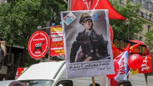 nouvel ordre mondial | Manifestation anti-Macron : une organisation juive porte plainte après l'exhibition d'une pancarte représentant le président en SS avec un brassard israélien