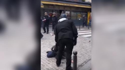 Un collaborateur de l'Élysée, filmé en train de frapper un manifestant le 1er mai à Paris, mis à pied avant d'être réintégré