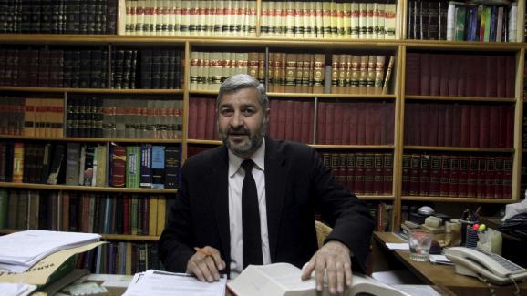 L\'avocatGhulam Mustafa Chaudhry dans son bureau à Lahore, au Pakistan, le 22 février 2016.