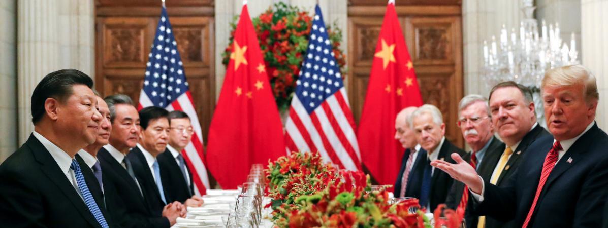 Le président chinois Xi Jinping et son homologue américain Donald Trump lors d\'un dîner de travail en marge du sommet du G20 à Buenos Aires (Argentine), le 1er décembre 2018.