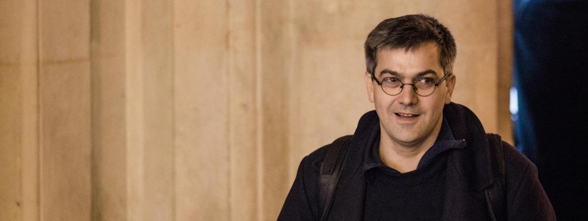 Julien Coupat arrive au tribunal de grande instance de Paris lors du deuxième jour du procès Tarnac, le 14 mars 2018.