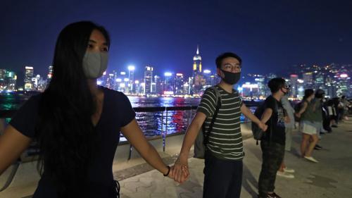EN IMAGES. A Hong Kong, des milliers de manifestants prodémocratie forment une immense chaîne humaine