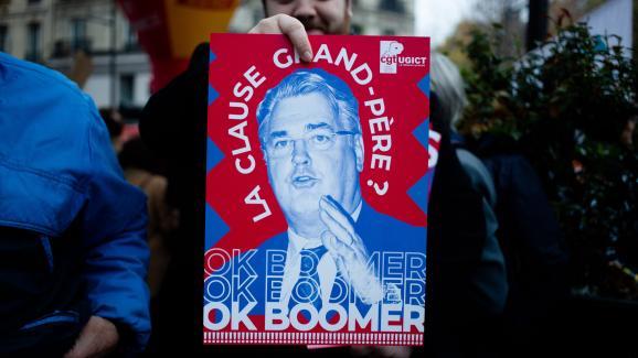 Une affiche de la CGT lors de la manifestation du 5 décembre 2019, à Paris, contre le projet deréforme des retraites.