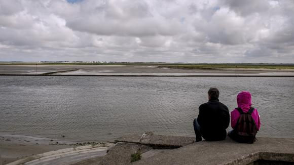 A couple contemplates the Somme Bay.  Illustrative photo.