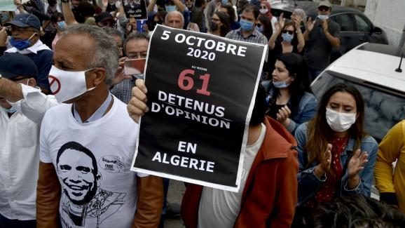 Algerians participate in a weekly rally to call for the release of journalist Khaled Drareni in Algiers, October 5, 2020. The 40-year-old Algerian journalist, imprisoned since March 29, was sentenced on appeal to two years in prison.