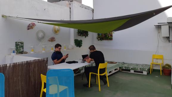 Foreign employees teleworking on the terrace of their rental in Tenerife (Canary Islands) on March 30, 2021