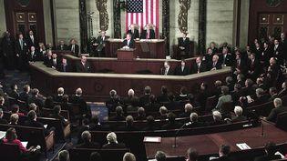 George W. Bush tient son discours sur l'état de l'Union, le 29 janvier 2002 à Washington (Etats-Unis). (PAUL J. RICHARDS / AFP)
