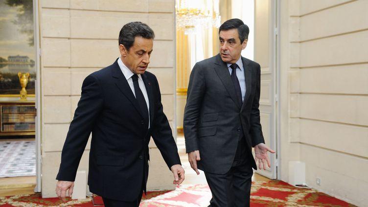 Le chef de l'Etat, Nicolas Sarkozy, et le Premier ministre, François Fillon, le 13 janvier 2012 à l'Elysée. (WITT / SIPA)