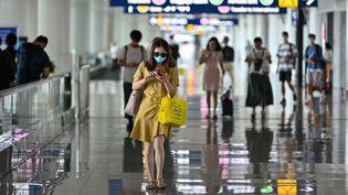 En Chine, les aéroports sont placés sous haute surveillance (illustration). (HECTOR RETAMAL / AFP)
