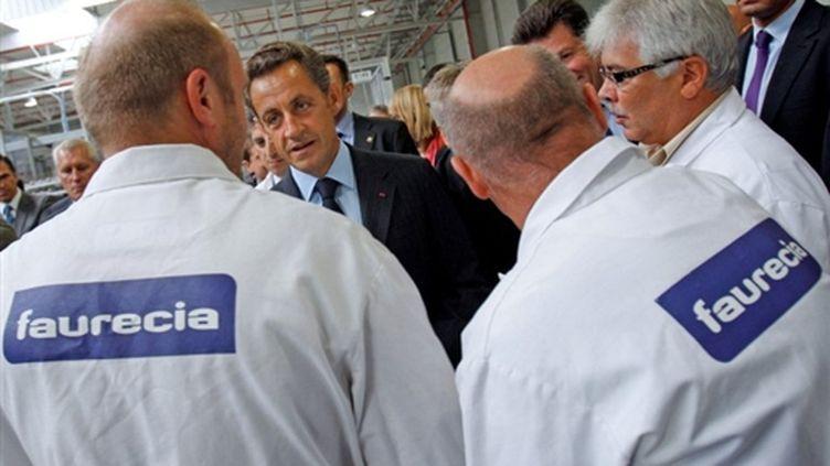 La visite de Nicolas Sarkozy à l'usine Faurecia de Caligny le 3 septembre (© AFP/CHRISTOPHE ENA)
