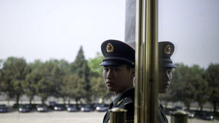 Une nouvelle loi en Chine, adpotée le 28 avril 2016, donne aux autorités et à la police des pouvoirs illimités pour contrôler les ONG. (FRED DUFOUR / AFP)