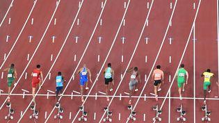 Les séries du 100 m masculin aux Jeux olympiques de Tokyo, le 31 juillet 2021. (ANTONIN THUILLIER / AFP)