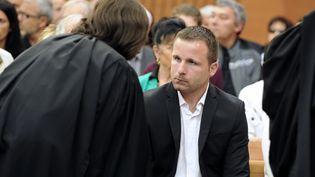 Nicolas Cano, le beau-fils de Manuela Gonzalez, condamnée à 30 ans de prison pour le meurtre de son père Daniel Cano, vendredi 18 avril 2014, à la cour d'assises deGrenoble (Isère). (JEAN-PIERRE CLATOT / AFP)