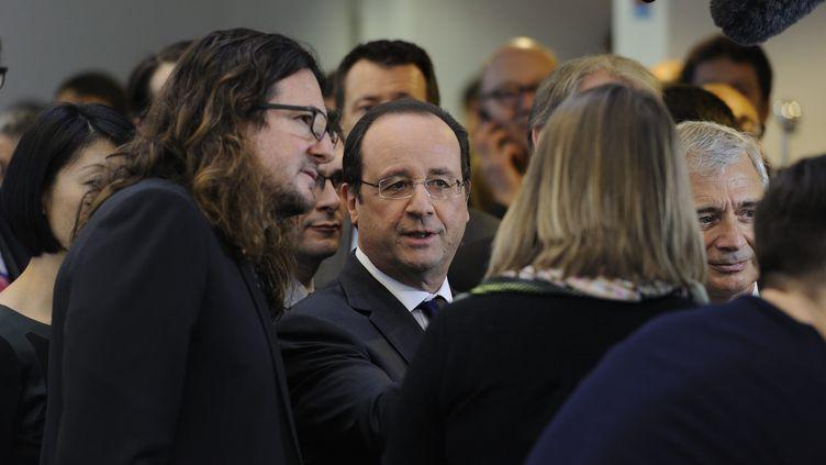 François Hollande aux côtés de Jacques-Antoine Granjon, le fondateur deVente-privée.com, le 6 février 2014 à La Plaine Saint-Denis (Seine-Saint-Denis). (  MAXPPP)