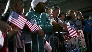 Des supporters de Bernie Sanders lors d'un meeting du candidat aux primaires démocrates, à Des Moines (Etats-Unis), le 31 janvier 2016. (ALEX WONG / GETTY IMAGES NORTH AMERICA / AFP)