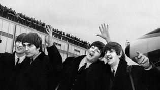 Les Beatles en 1964  (AFP)