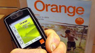 Selon Orange, Free Mobile a déjà 1,5 millions d'abonnés, un mois après son lancement. (MYCHELE DANIAU / AFP)