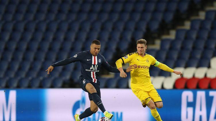 Kylian Mbappe en action lors du dernier match officiel du PSG le 11 mars 2020 face à Dortmund en 8e de finale de Ligue des Champions. (- / GETTY/UEFA)