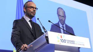 Edouard Philippe s'adresse aux maires à l'occasion de leur 100e congrès. (JACQUES DEMARTHON / AFP)