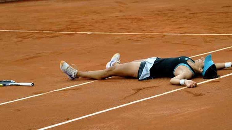 Caroline Garcia savoure sa victoire en finale contre Jelena Jankovic le 13 avril dernier, à Bogota.  (GUILLERMO LEGARIA / AFP)