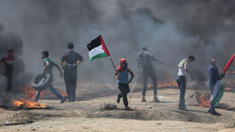 Des manifestants palestiniens dans la bande de Gaza le 14 mai 2018. (MHMED ALI / CROWDSPARK / AFP)