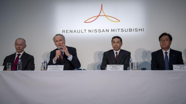 Le PDG de Renault, Jean-Dominique Senard, et son homologue de Nissan,Hiroto Saikawa, donnent une conférence de presse, le 12 mars 2019 à Yokohama (Japon). (ALESSANDRO DI CIOMMO / NURPHOTO / AFP)