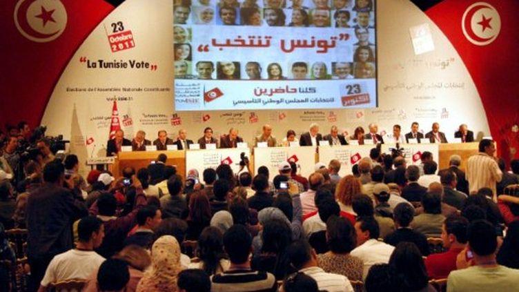 Proclamation des résultats officiels à Tunis par la commission électorale, le 27 octobre. (SALAH HABIBI / AFP)