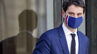 Le porte-parole du gouvernement, Gabriel Attal, à l'Elysée (Paris), le 3 mars 2021. (LUDOVIC MARIN / AFP)