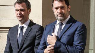 Les ministres de la Santé et de l'Intérieur Olivier Véran et Christophe Castaner sur le perron de l'Elysée, à Paris, le 13 mars 2020. (LUDOVIC MARIN / AFP)