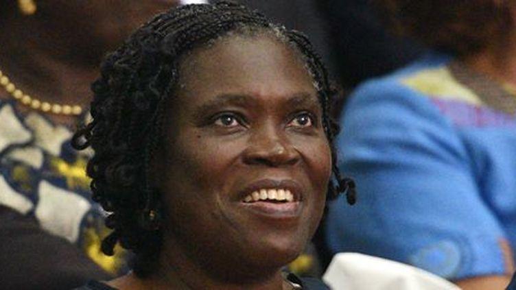 Simone Gbagbo, l'ancienne première dame de Côte-d'Ivoire, au tribunal d'Abidjan pour l'ouverture de son procès, le 26 décembre 2014. (AFP PHOTO / SIA KAMBOU)