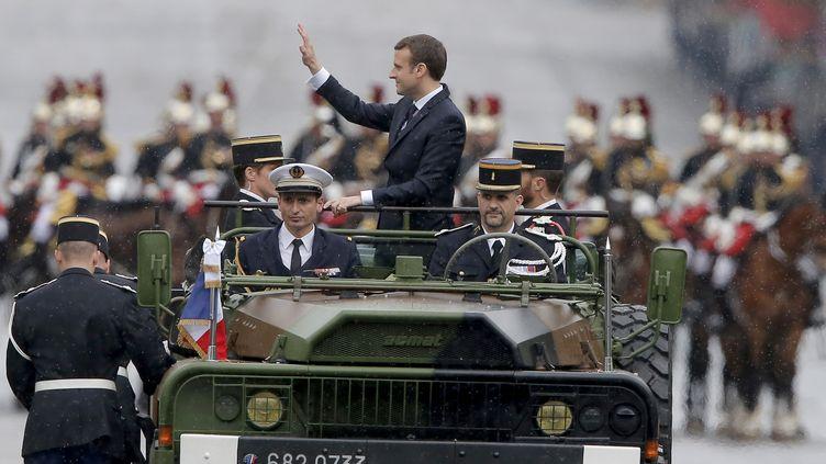 Emmanuel Macron sur les Champs-Elysées à Paris, le 14 mai 2017. (MICHEL EULER / AFP)