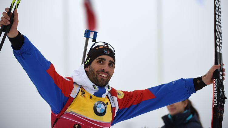 Le biathlète français, Martin Fourcade, peut savourer après son troisième titre mondial en trois courses... (HENDRIK SCHMIDT / DPA)