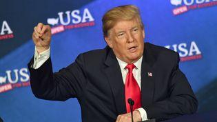 Donald Trump, le 4 mai 2018, à Dallas (Texas), lors du congrès annuel de la NRA, le lobby des armes aux Etats-Unis. (NICHOLAS KAMM / AFP)