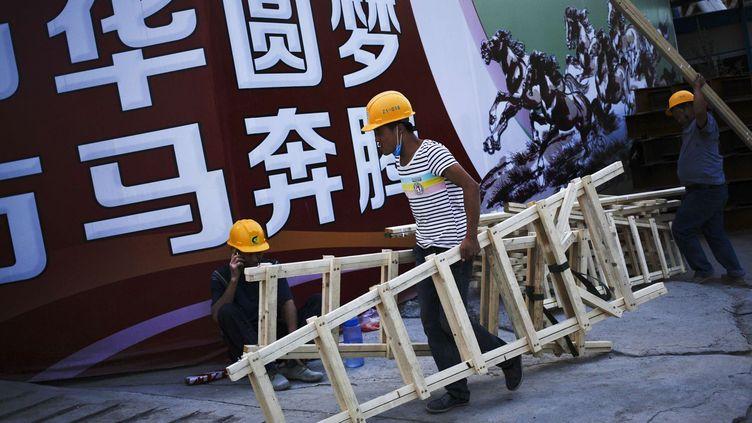 Un rêve assombri par le poids colossal de la dette des entreprises chinoises, soit 165% du PIB en 2015. Une situation exceptionnelle dans un pays émergent. (SIPA/AP Photo/Andy Wong)