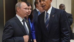 Le président russe Vladimir Poutine et son homologue américain au sommet du G20 à Hangzhou, en Chine, le 5 septembre 2016. (SPUTNIK PHOTO AGENCY / REUTERS)