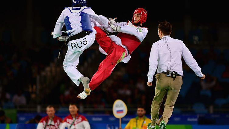 Taekwondo. JO Rio de Janeiro, Brésil. 18 août 2016.Le russe Alexey Denisenko contre le jordanien Ahmad Abughaush catégorie 68kg. (LAURENCE GRIFFITHS / GETTY IMAGES)