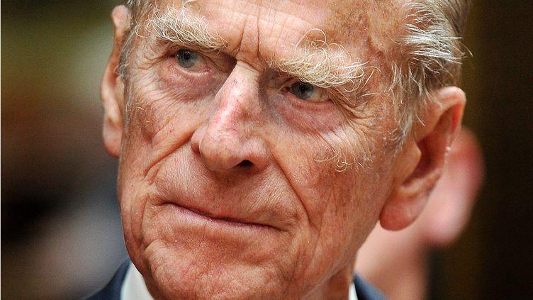 Le prince Philip, duc d'Édimbourg de Grande-Bretagne, assiste à une réception au palais de Buckingham, le 10 juin 2011. Photo d'illustration. (JOHN STILLWELL / POOL / AFP)