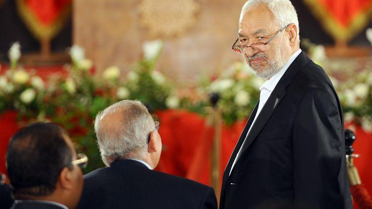 Rached Ghannouchi, le chef d'Ennahda, au Palais des Congrès, à Tunis, peu de temps avant la signature d'une feuille de route qui prévoit le départ de son parti du gouvernement, samedi 5 octobre. (FETHI BELAID / AFP)